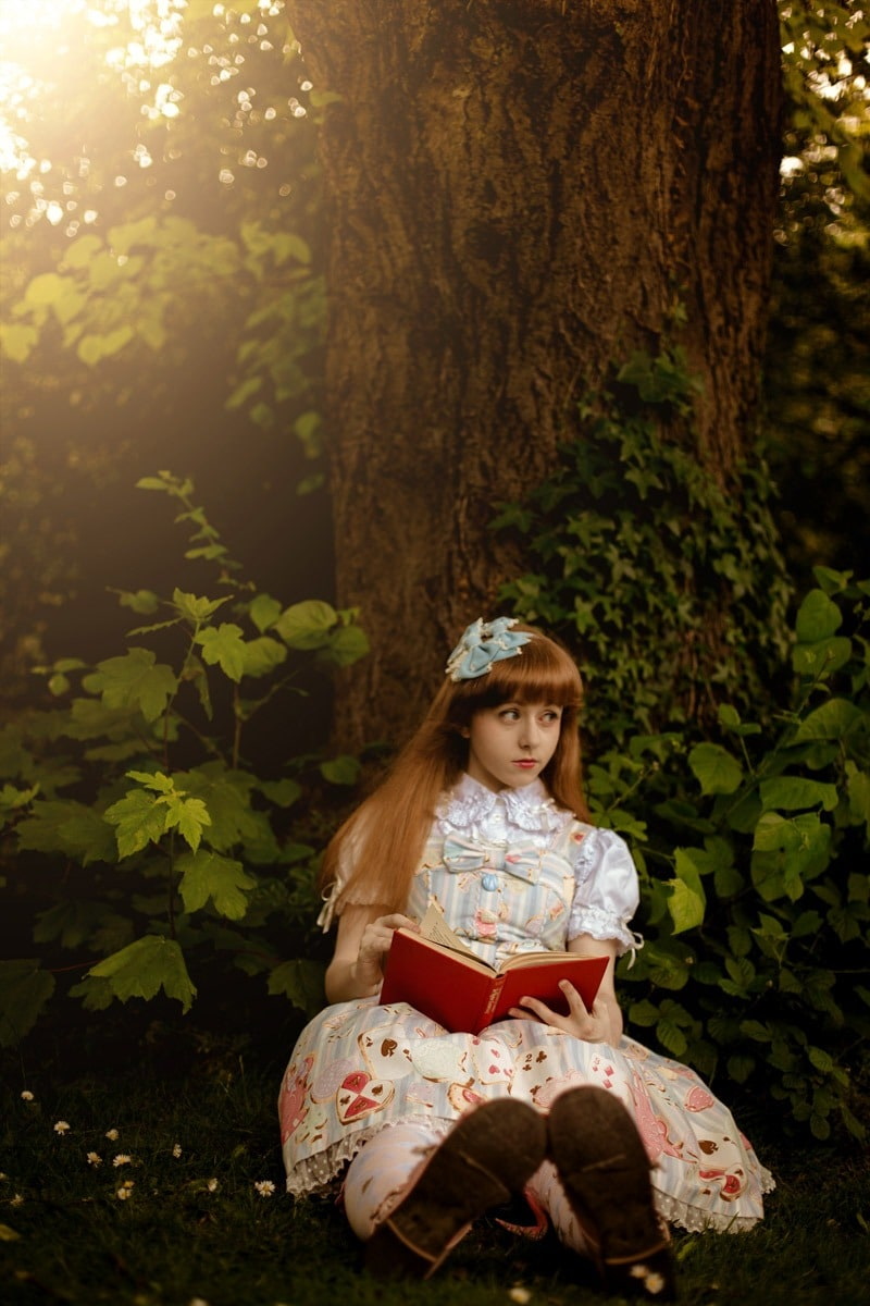 alice in wonderland reading a book photography