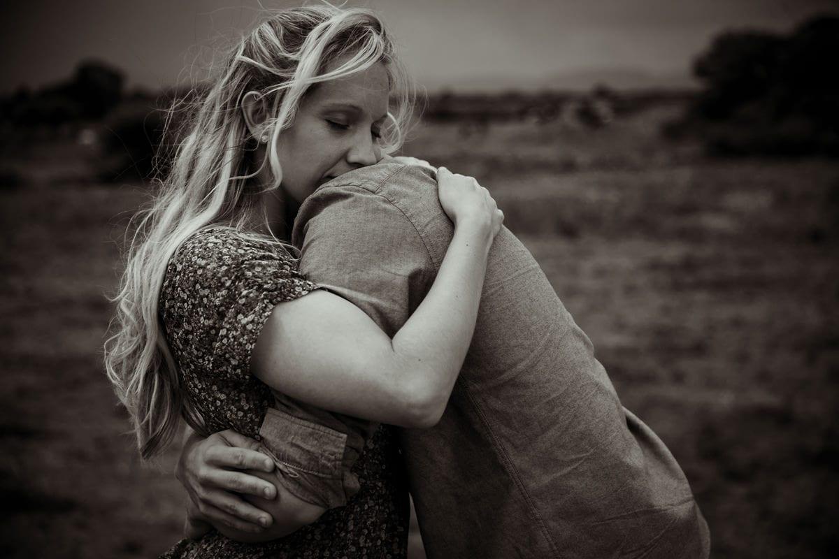 girl holding her boyfriend romantic hug