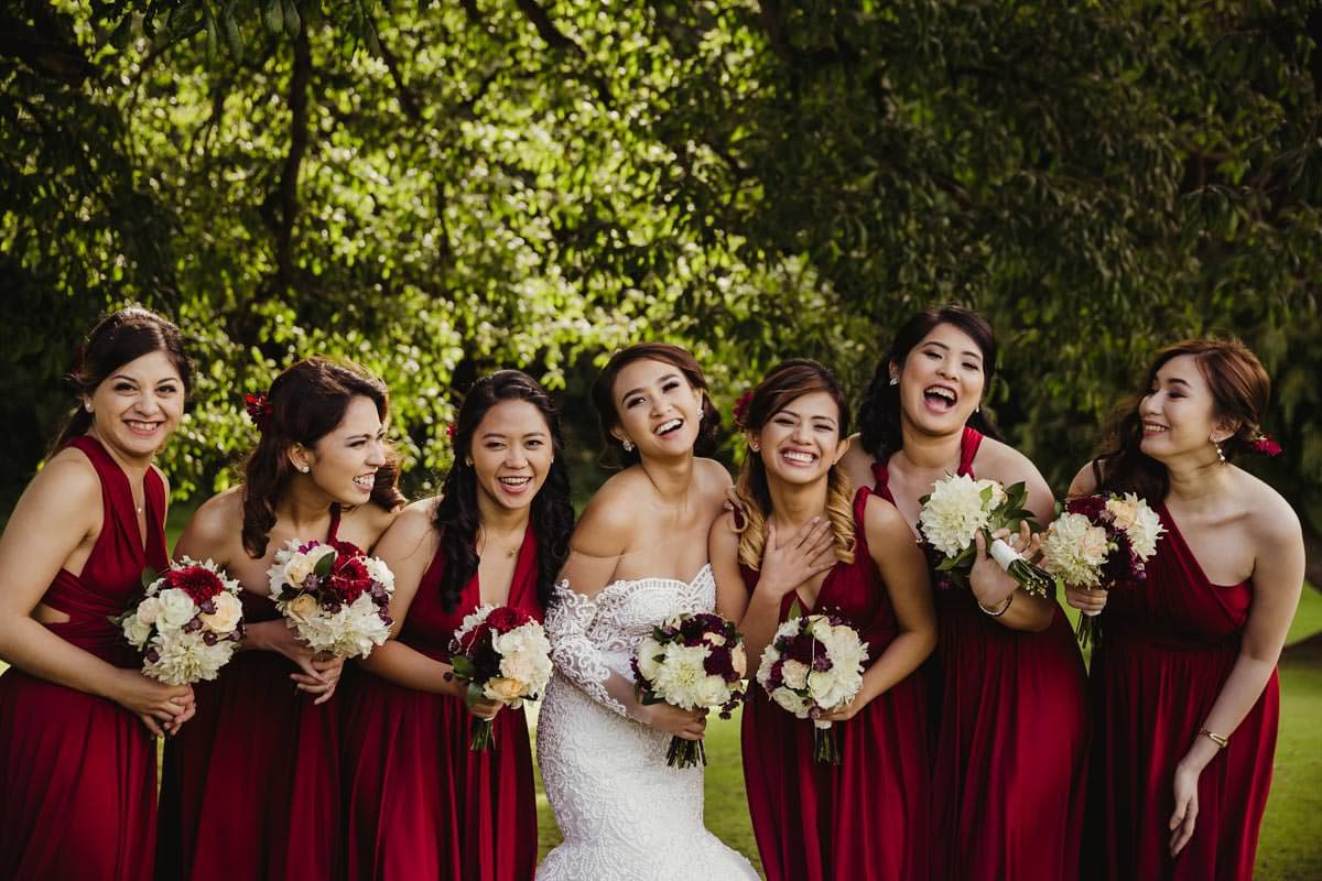 Bridal party photo ideas bridesmaids in red infinity dresses
