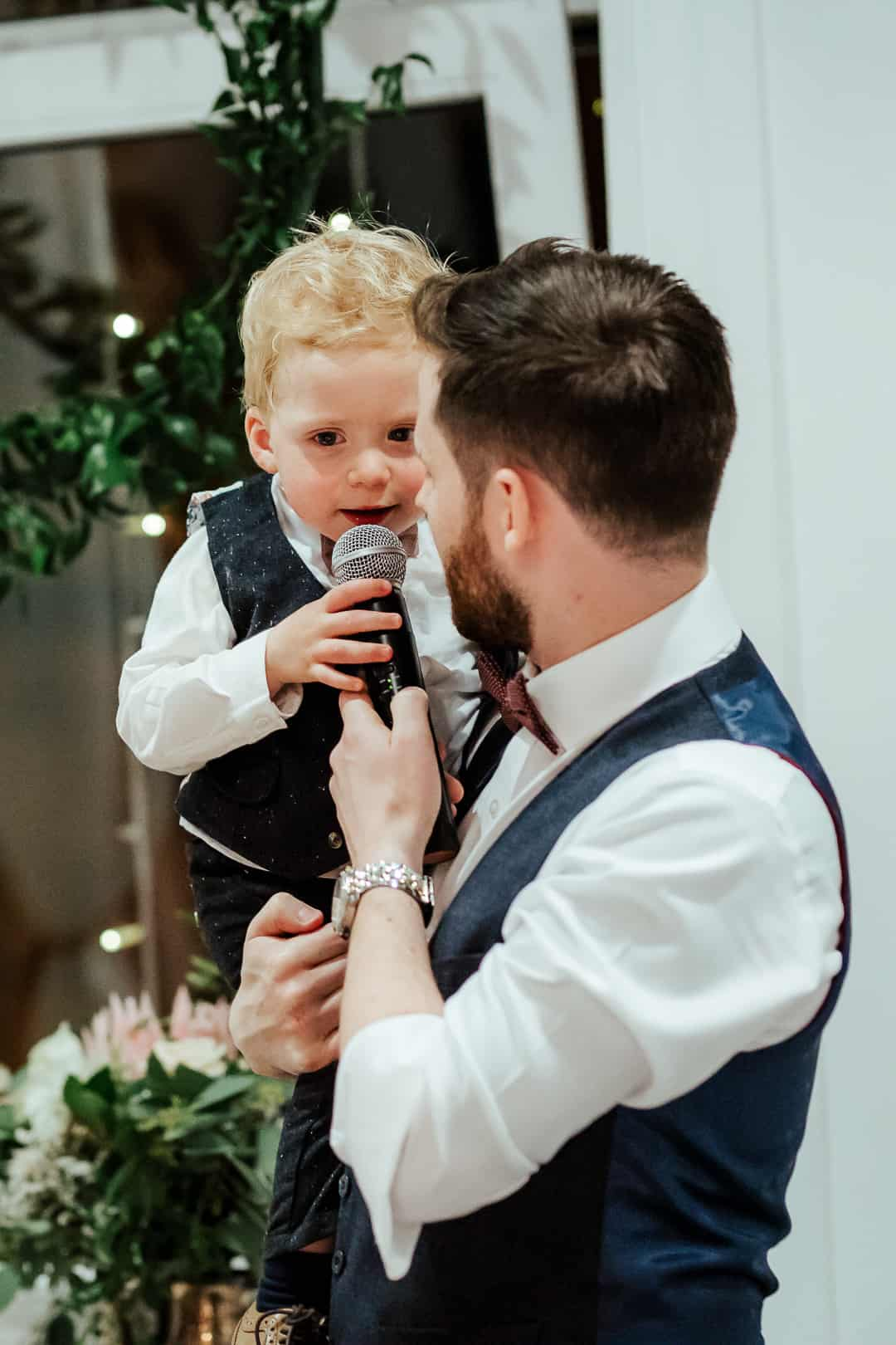 bride and groom's little kid giving a speech