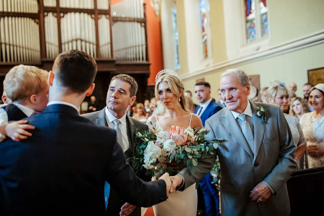 bride greeting the groom at the top of the aisle wedding at unitarian church dublin