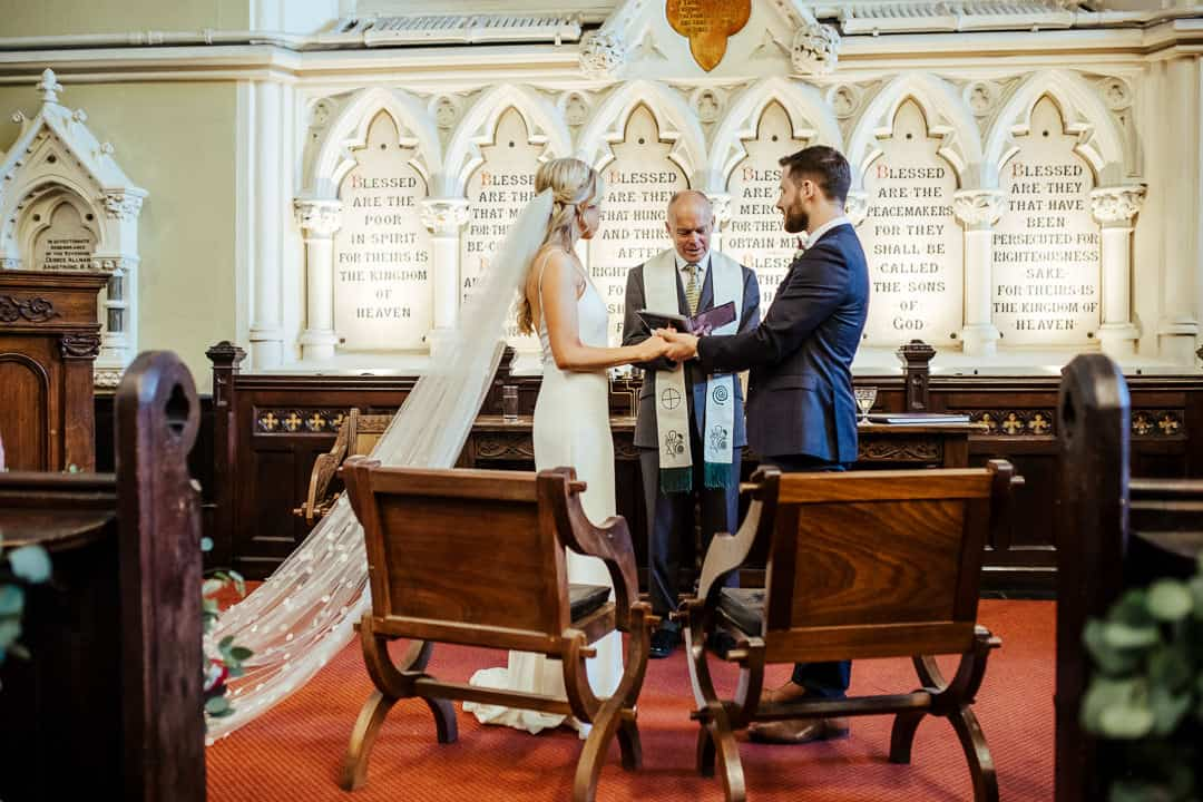 bride and groom saying their vows wedding at unitarian church dublin