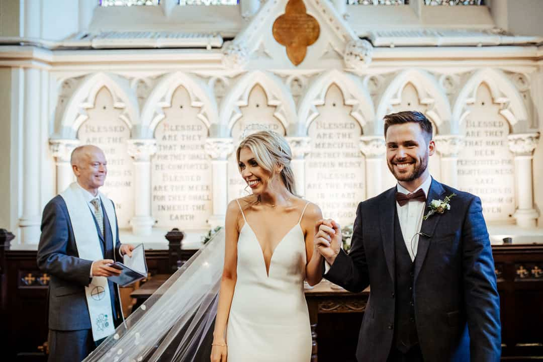 happy couple at their wedding ceremony at unitarian church dublin