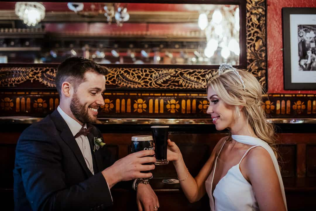 wedding couple sharing a pint of guinness at the long hall pub