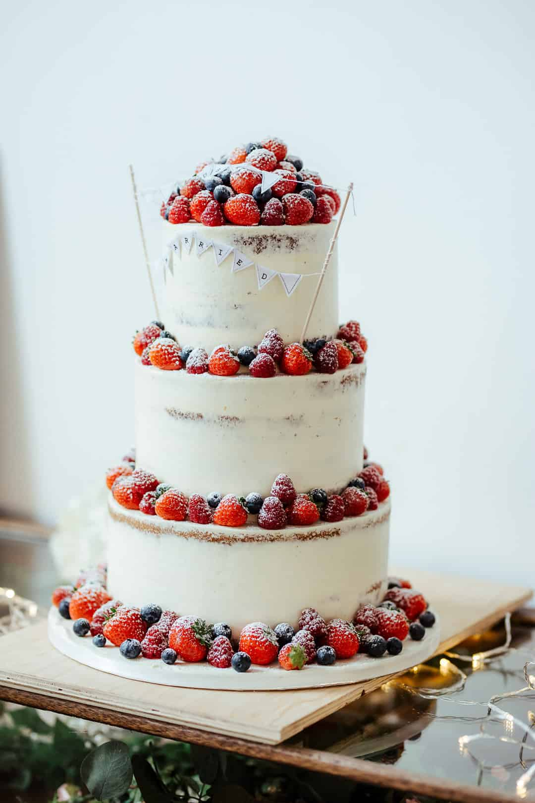 white wedding cake decorated with berries