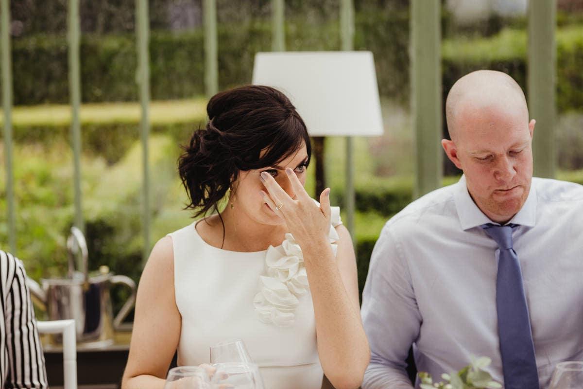 bride crying during wedding speeches candid wedding photographer dublin