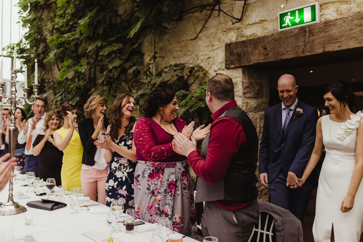 bride and groom enter the reception cliff at lyons intimate wedding