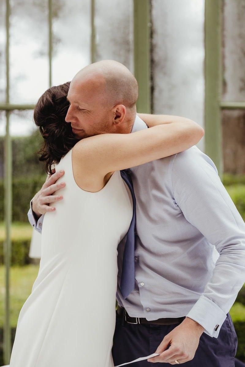 bride and groom hugging wedding speeches