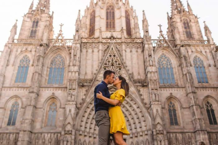 Couple kissing in front of Barcelona cathedral Gothic quarter Spain