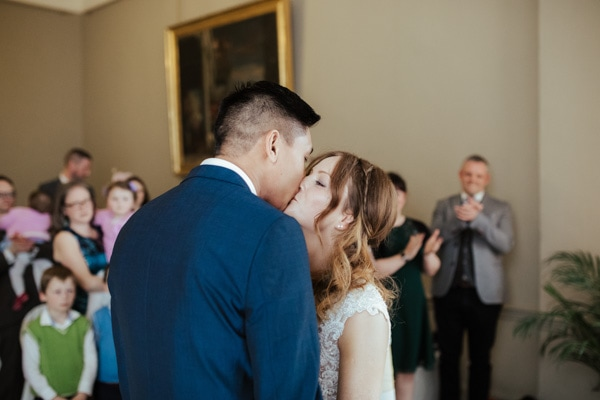 bride and groom first kiss dublin city wedding