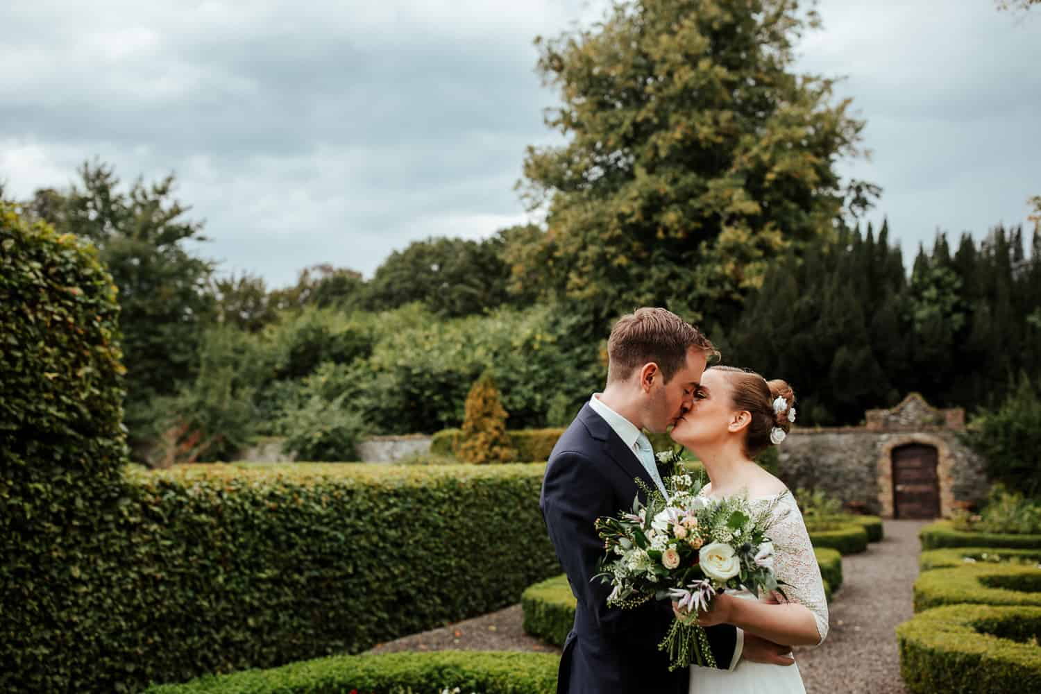 bride and groom in the secret garden at martinstown house