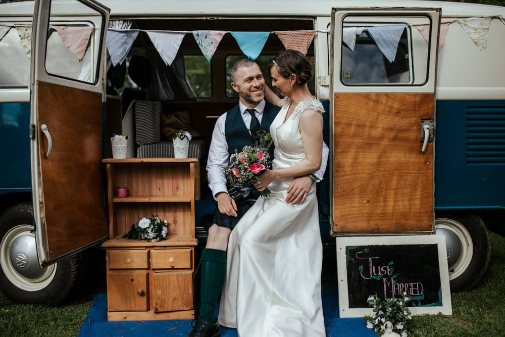 bride and groom in vintage campervan country house wedding venue martinstown house