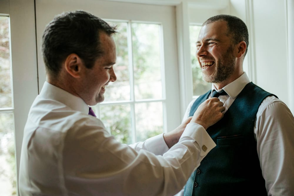 best man helping groom getting ready martinstown house wedding venue