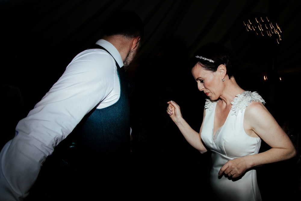 bride and groom dancing to retro music