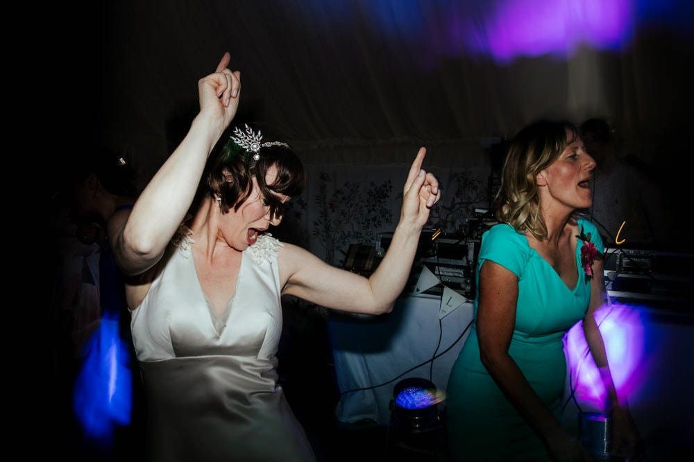 bride and her friends dancing at wedding reception