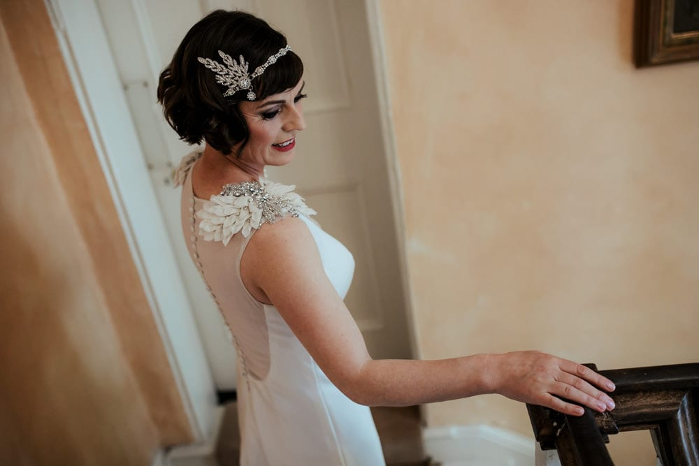 bride walking down the stairs vintage wedding gatsby style wedding hairpiece