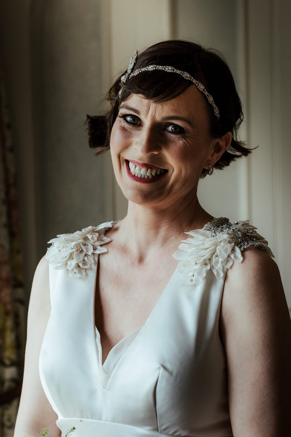 bride smiling at the camera vintage wedding ireland gatsby style wedding hairpiece dirty fabulous