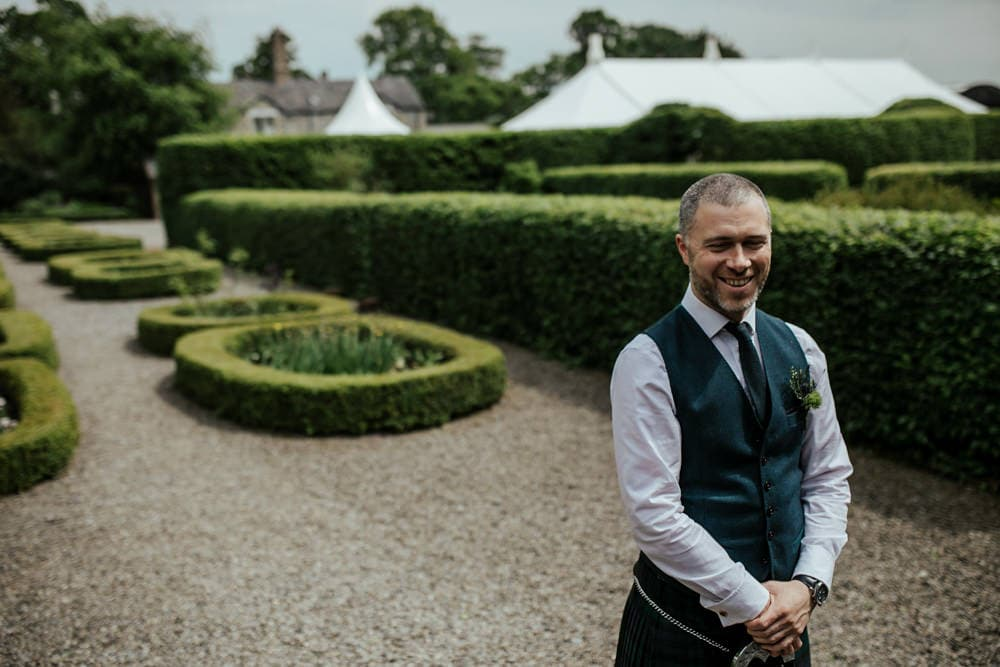 groom waiting to see the bride before the ceremony first look at martinstown house wedding
