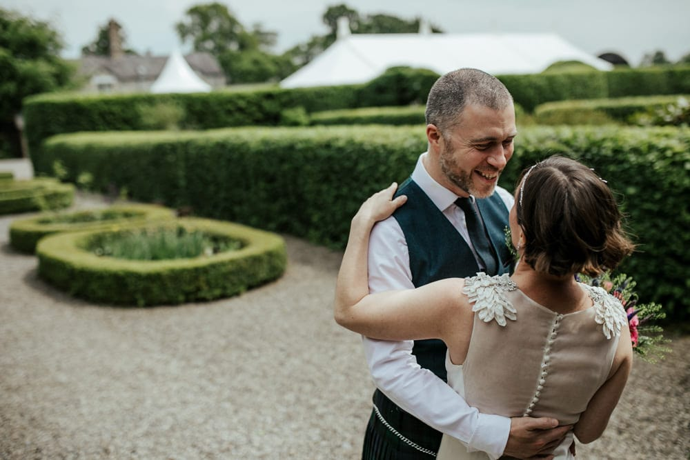 couple seeing each other for the first time on their wedding day first look documentary wedding photographer ireland