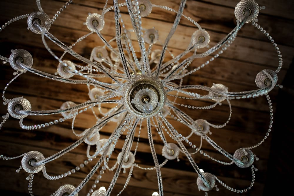 crystal chandelier in woodland ceremony area at martinstown house wedding venue kildare ireland