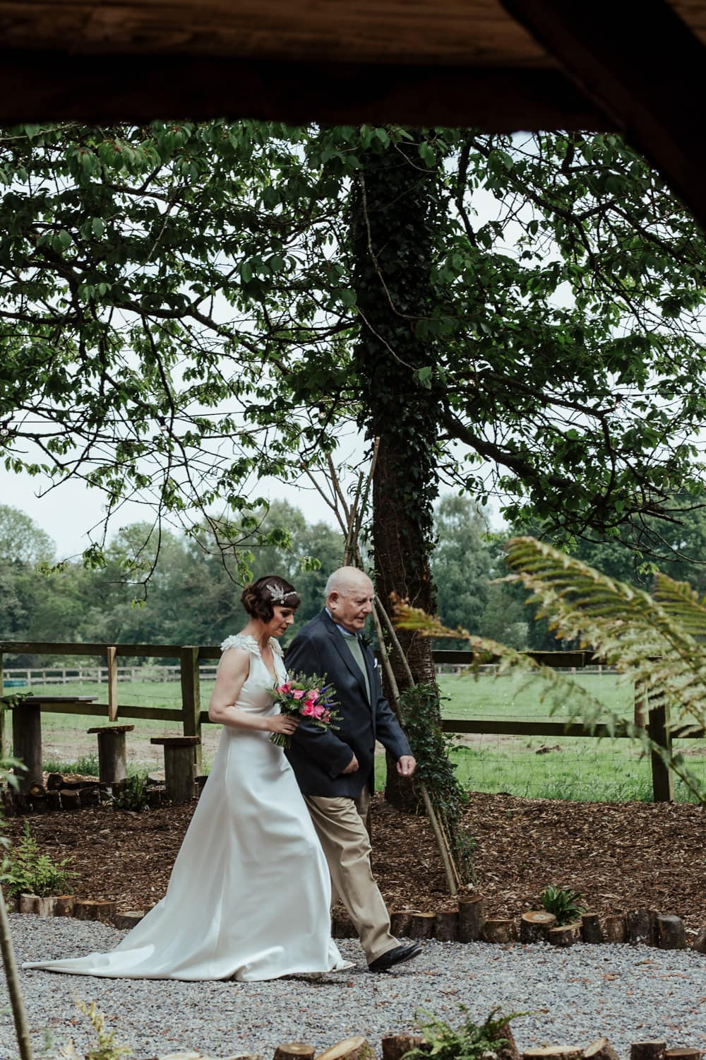 bride and her father walking up the aisle outdoor wedding ceremony ireland