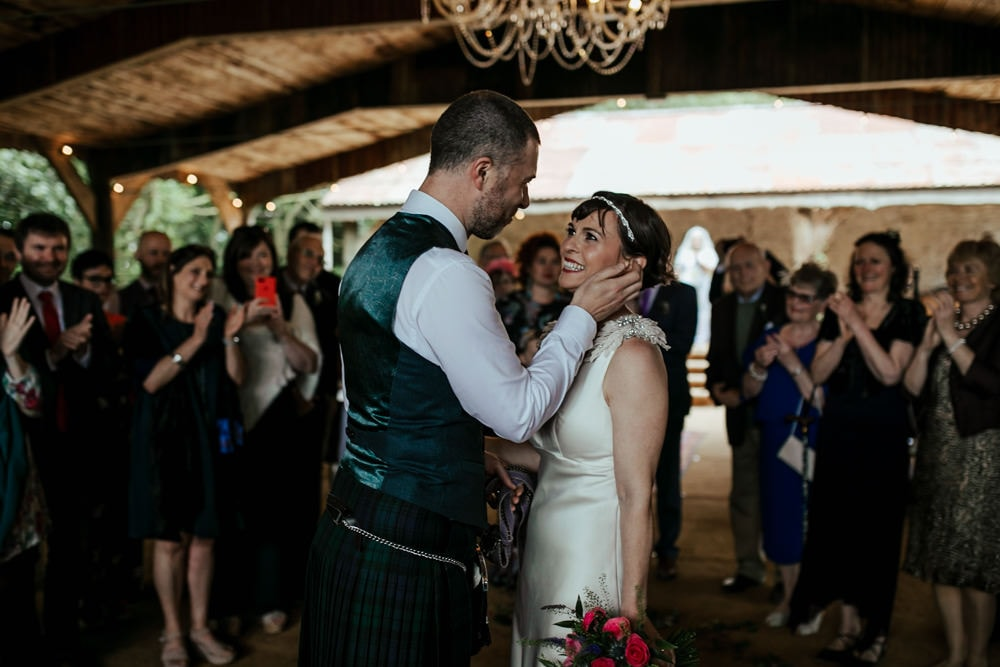 bride and groom first kiss martinstown house wedding venue