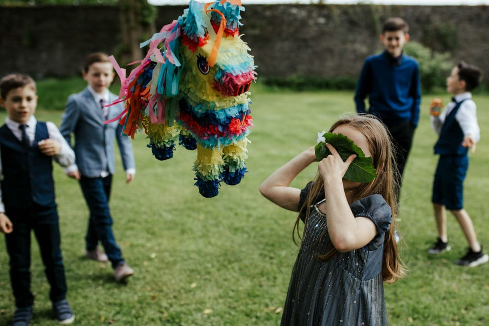 children playing pinata outdoor wedding games