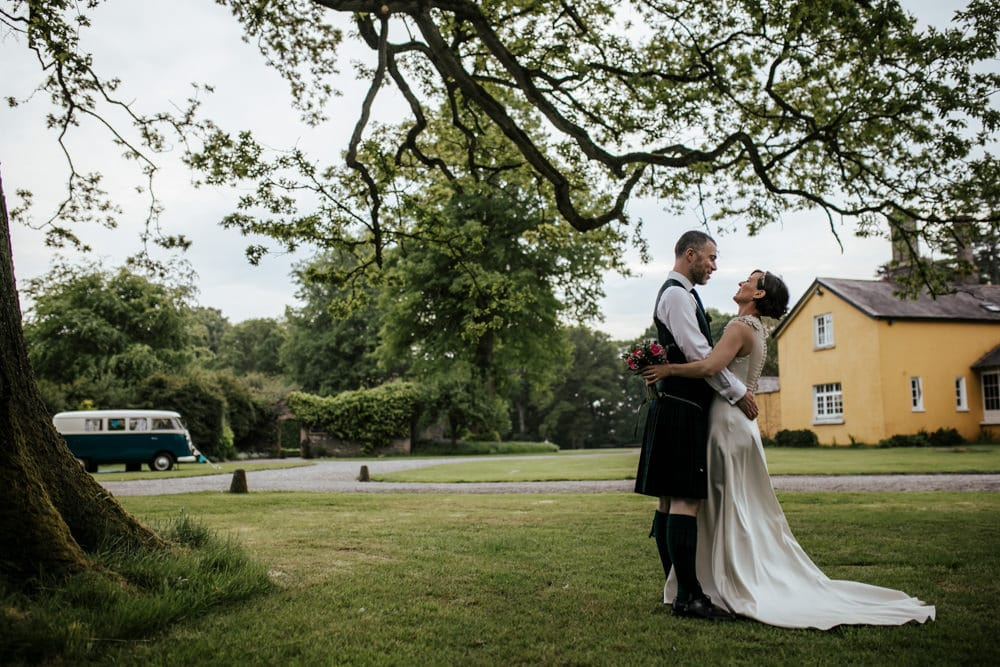 bride and groom holding each other at martinstown house vintage wedding