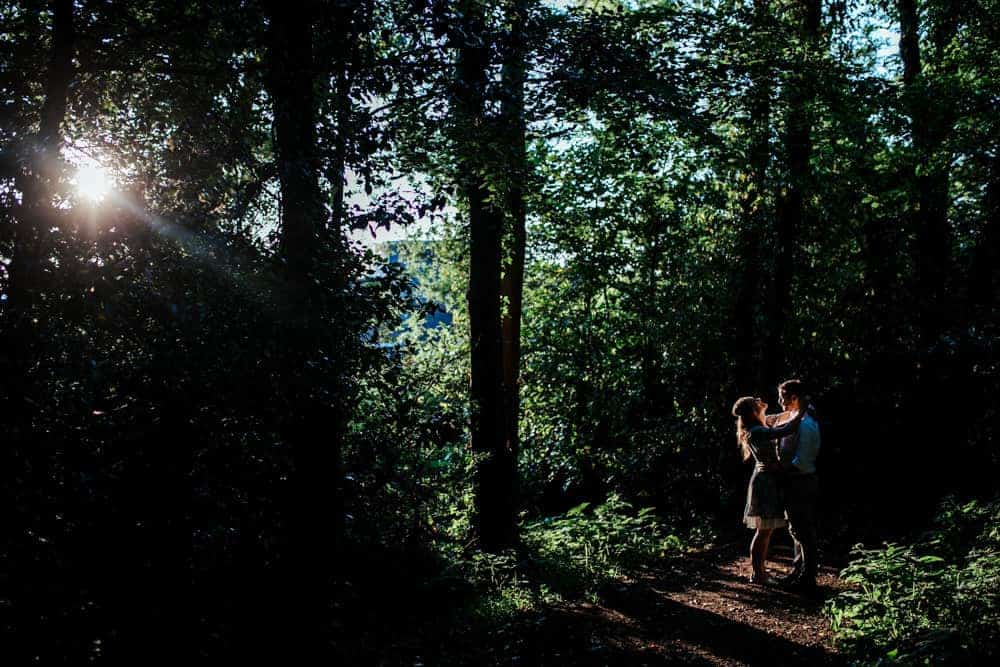 romantic photo of a couple in a forest sunset sun