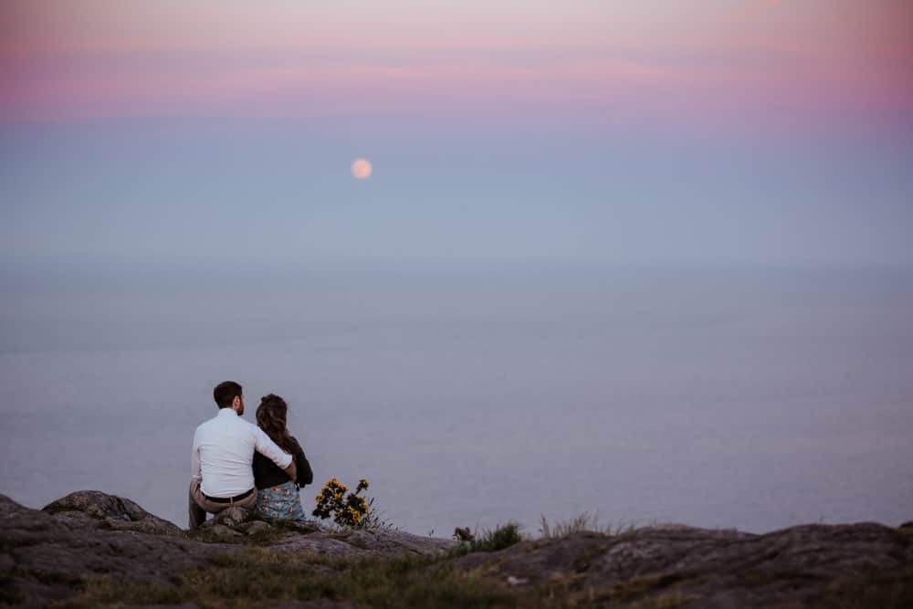engagement session at sunset couple under the moon