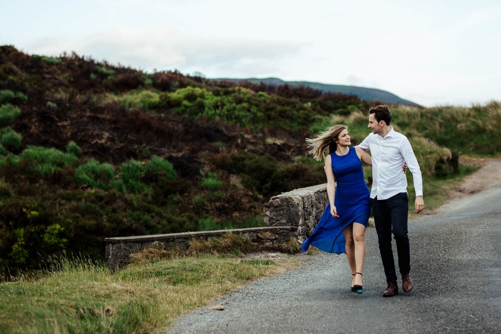couple taking a walk during their engagement session wicklow