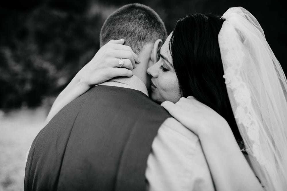 wedding couple kissing tenderly