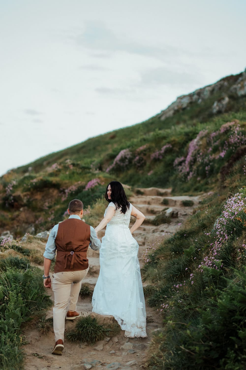 bride leading groom along howth cliff path vow renewal ireland