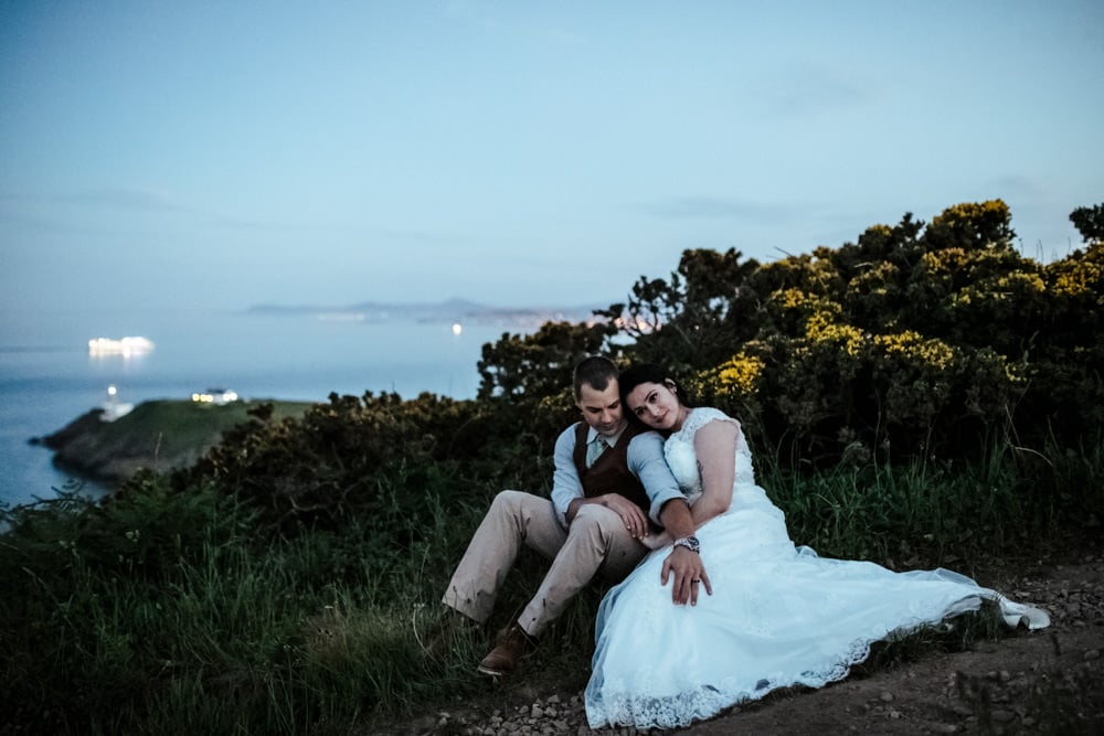 couple cuddling at howth head after sunset