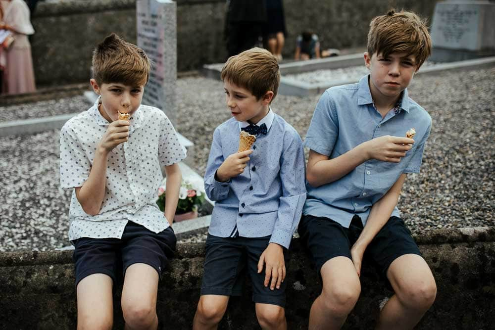 kids eating ice cream after church wedding