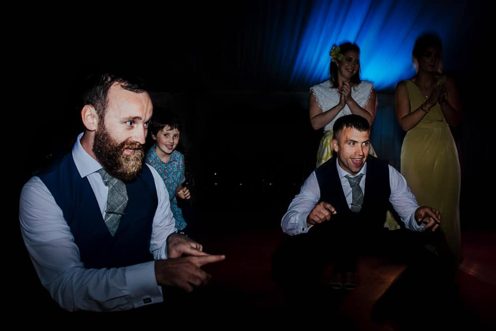 groomsmen dancing at wedding