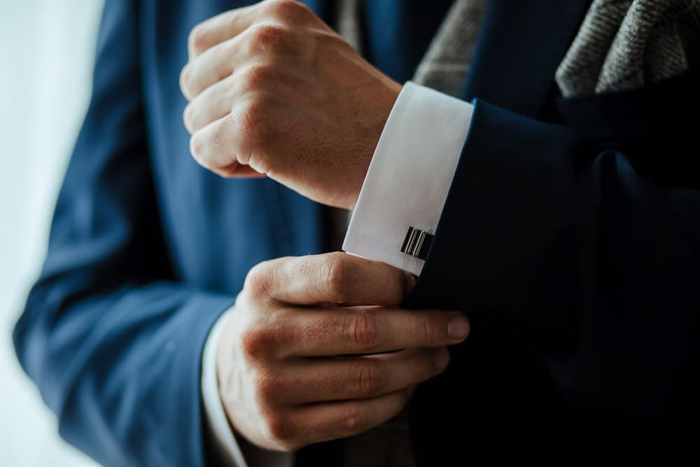 groom and cufflinks
