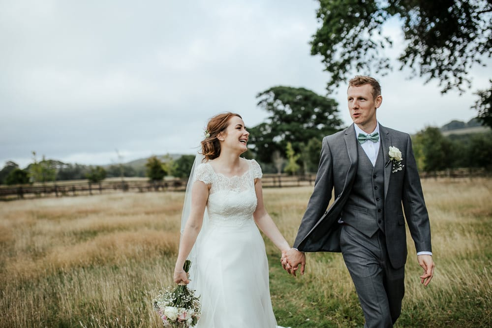 bride and groom walking through irish countryside horetown house wedding