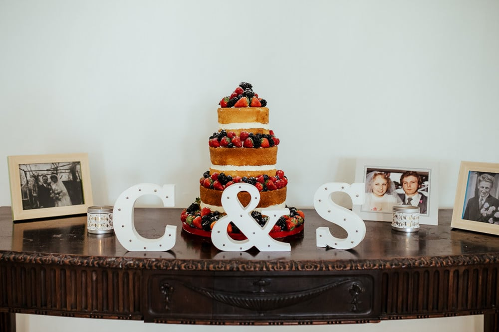 naked wedding cake decorated with berries horetown house wedding