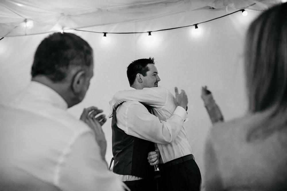 groom and best man hugging after best man's speech