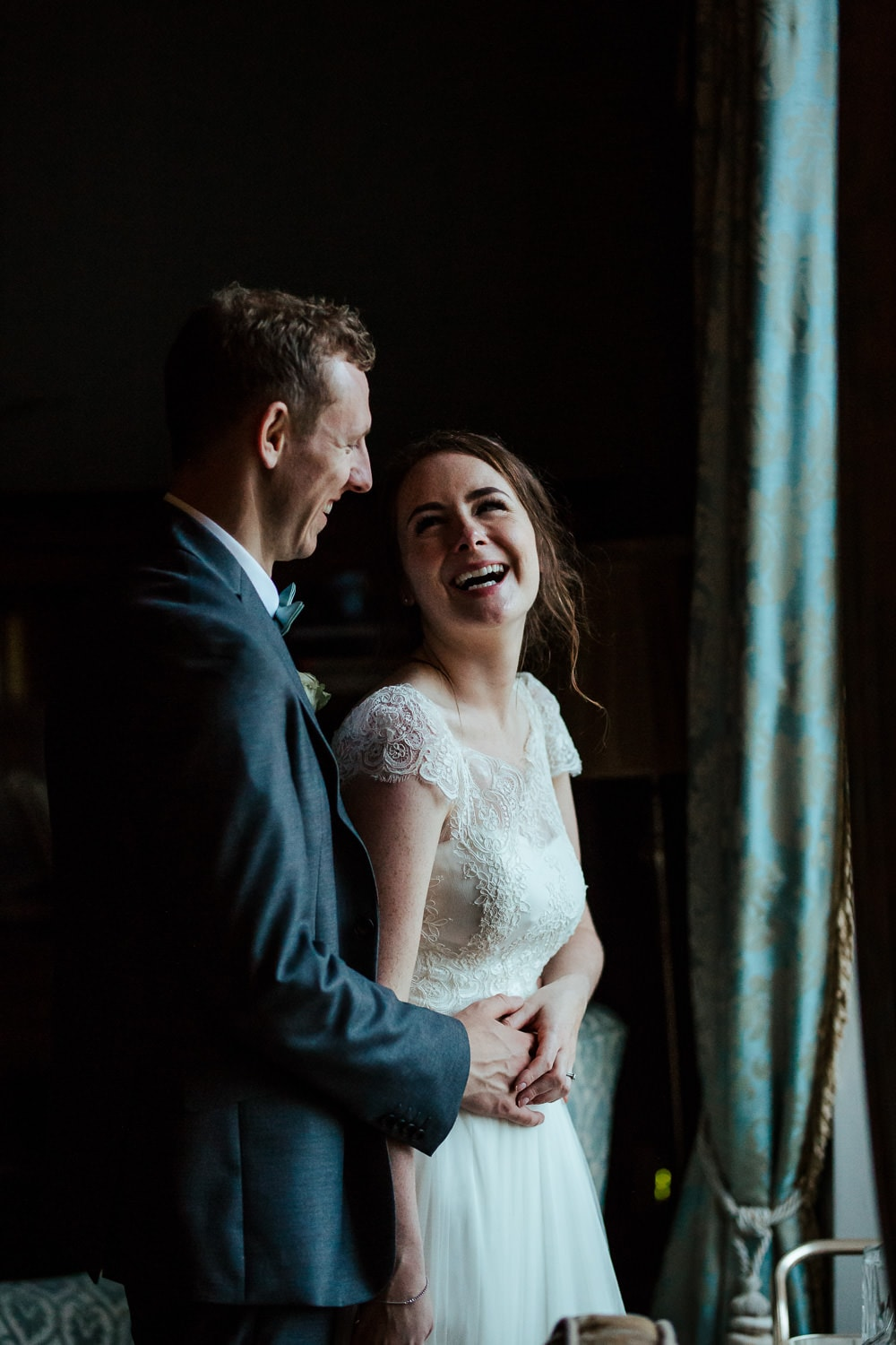 couple laughing on their horetown house wedding day
