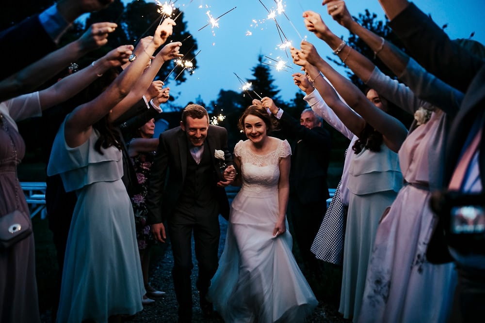 wedding couple sparkler exit ireland wedding photographer