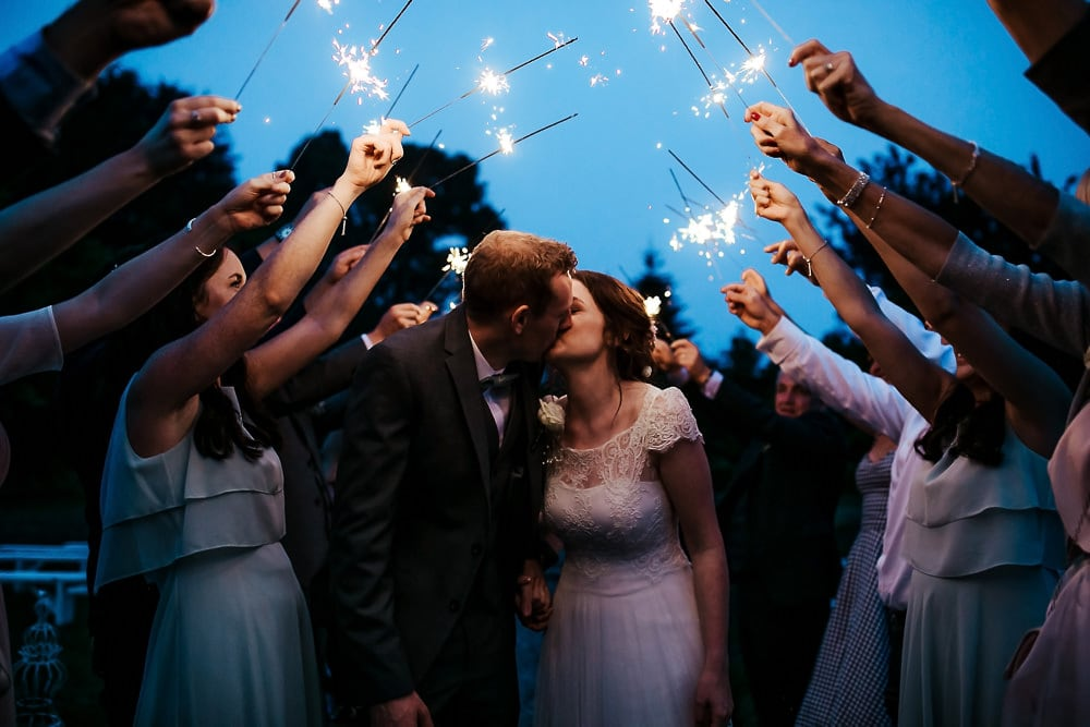 wedding couple kissing sparkler exit