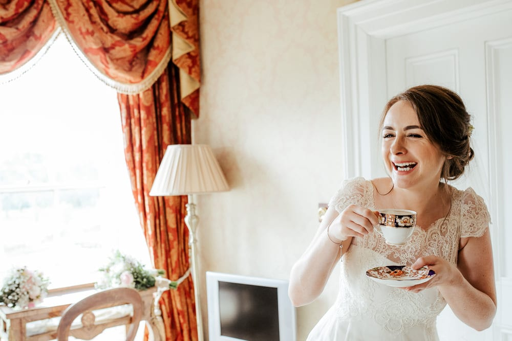 bride having a cup of tea before her wedding ceremony