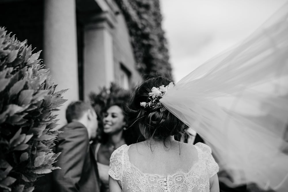 bride and her veil on a windy day
