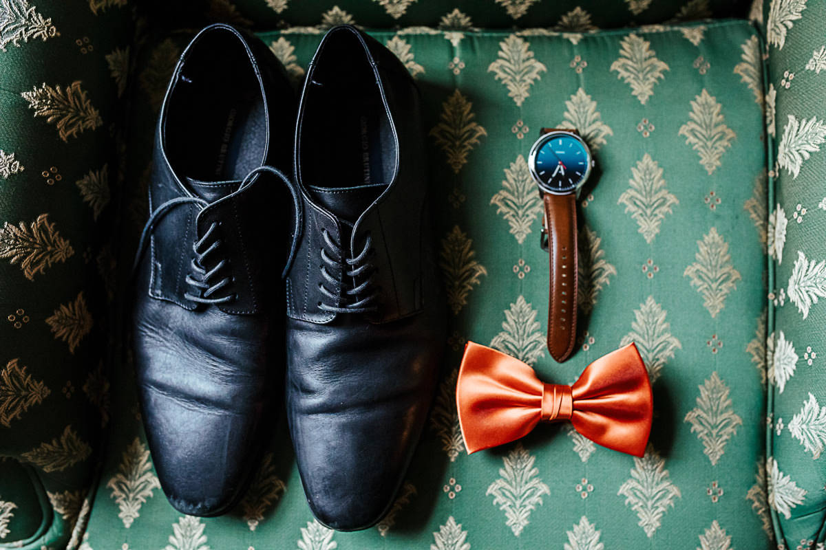 groom's wedding details - shoes watch and orange bow-tie