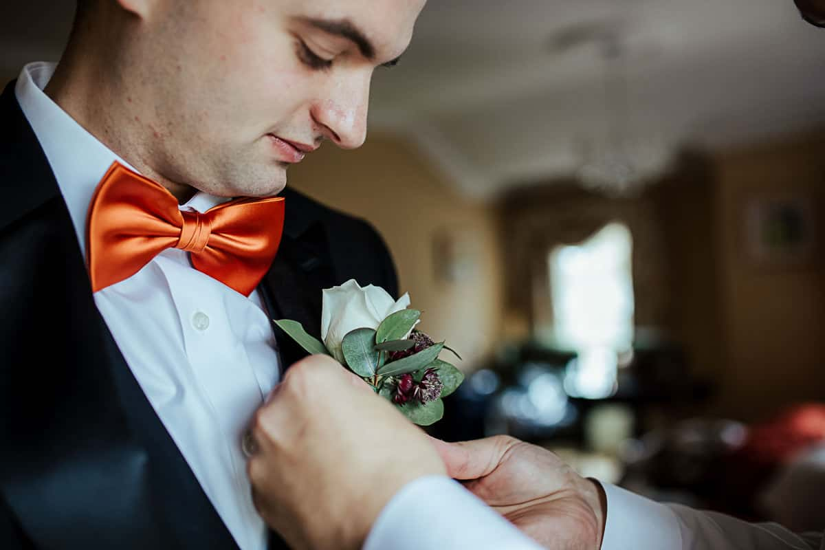 groom wedding details orange bow tie