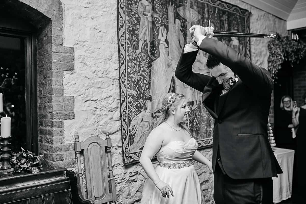 groom playing with sword