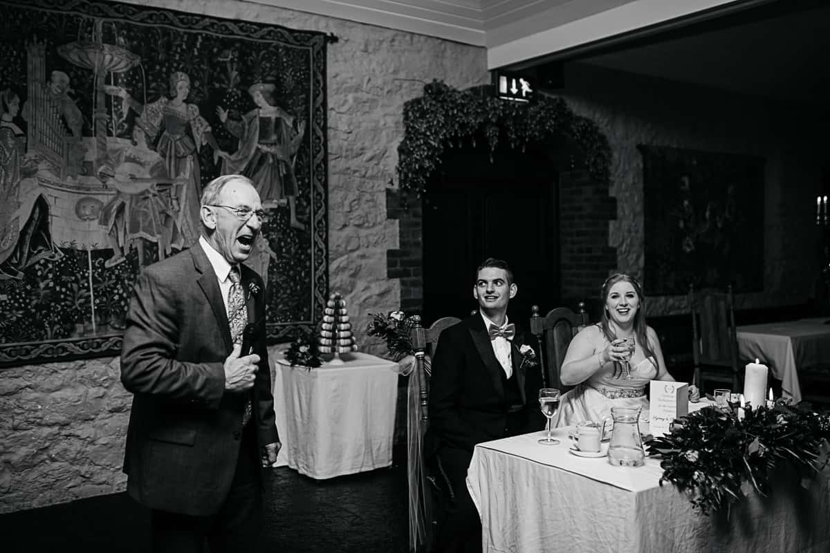 bride's grandfather giving an emotional wedding speech
