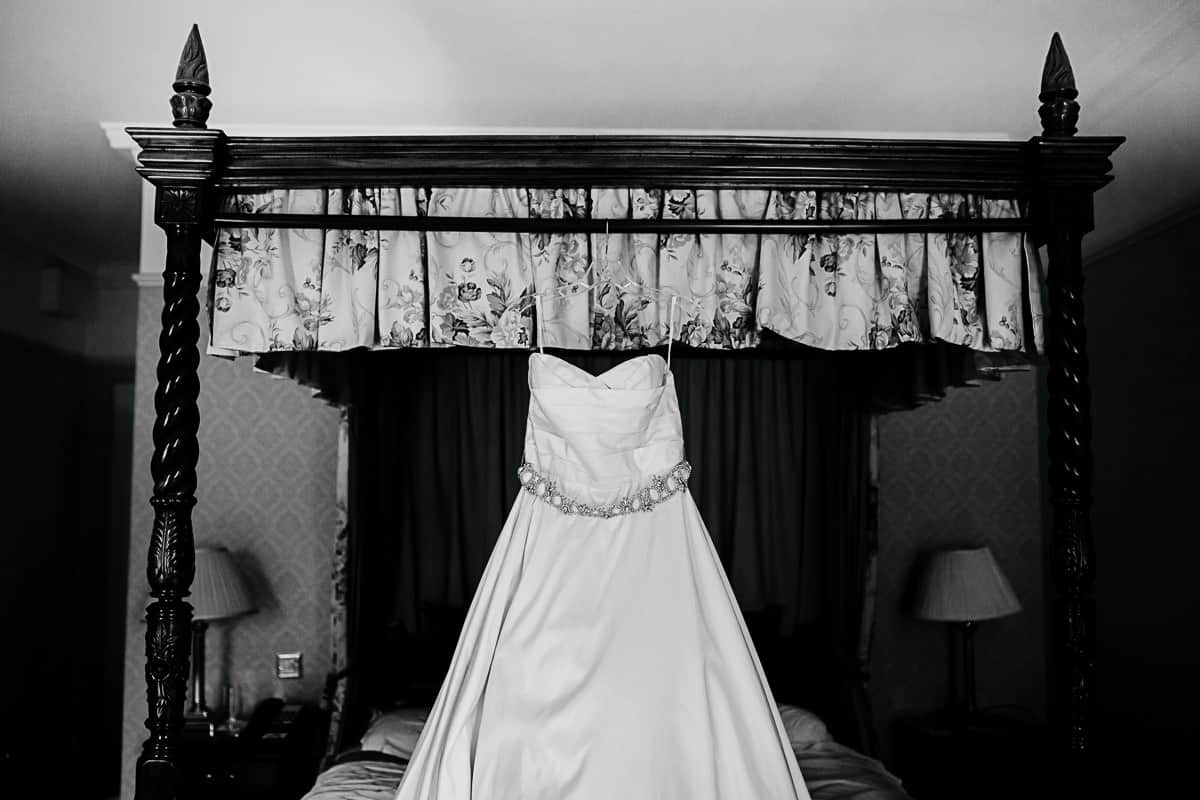 wedding dress hanging on a four poster bed barberstown castle wedding
